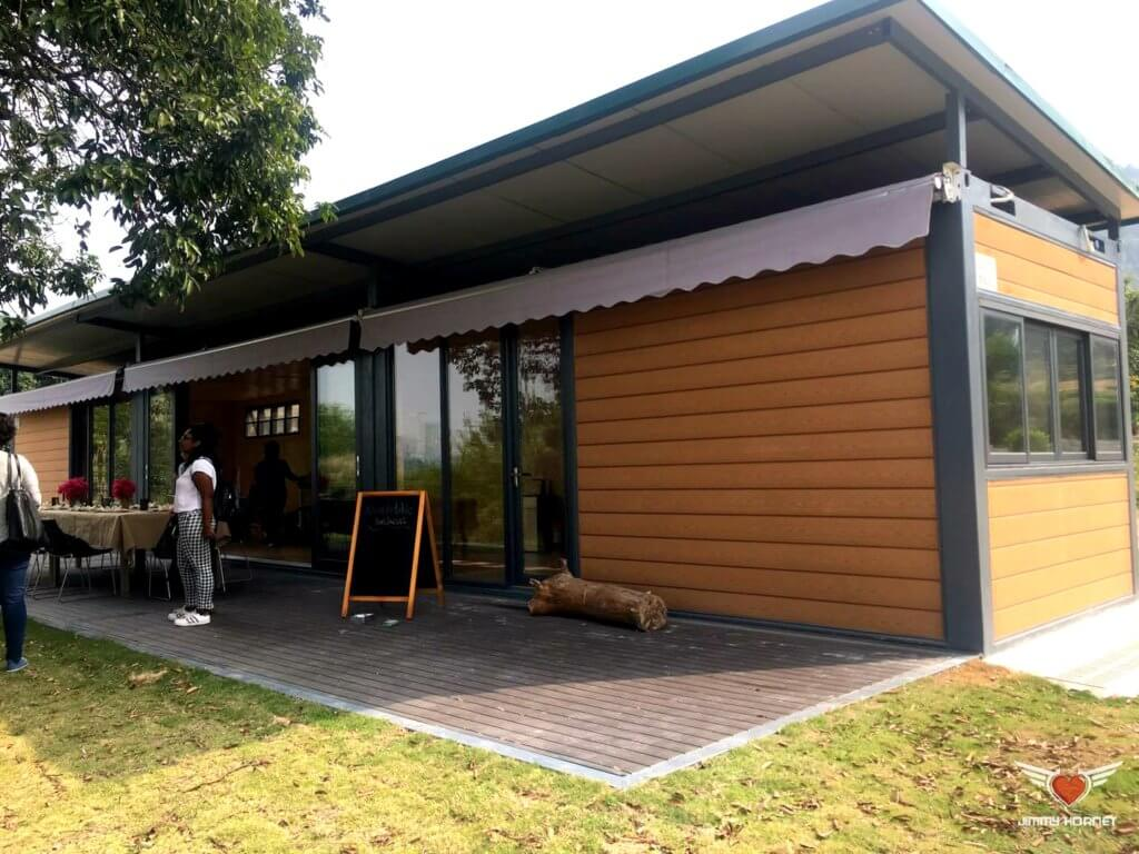 Shop constructed from containers at Flow Organic Farm and Animal Sanctuary