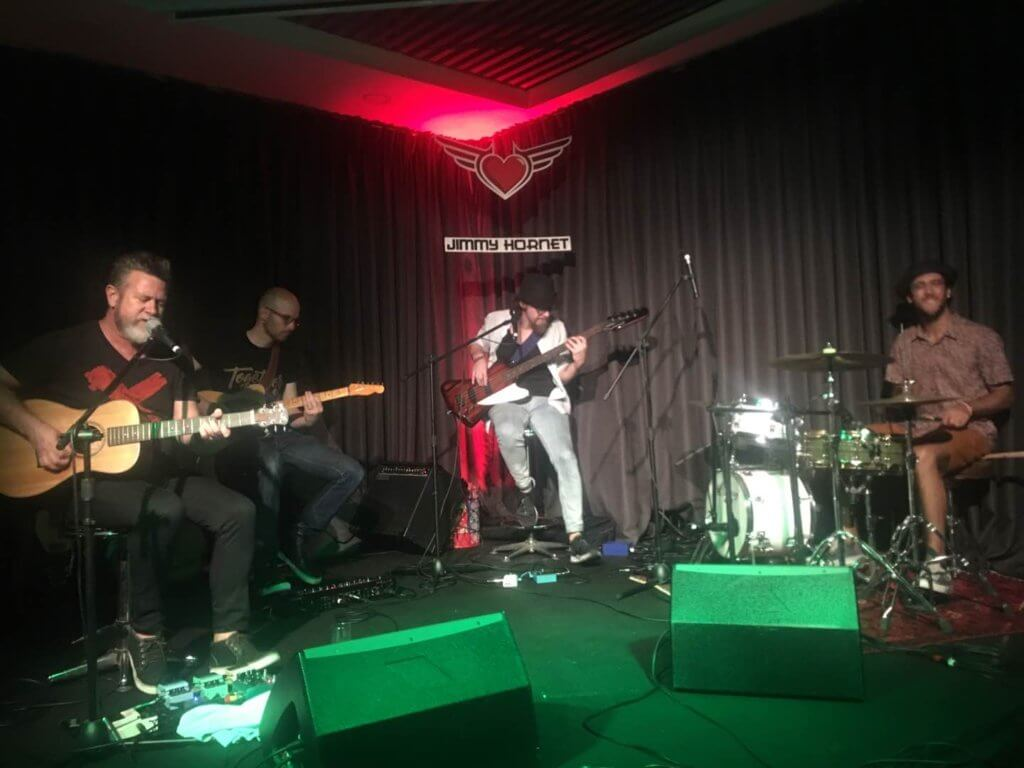 Glen Alfred and Band on stage at Jimmy Hornet China