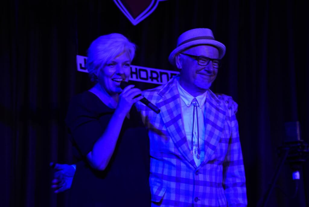 Anthea Palmer and Doc White on stage at Jimmy Hornet