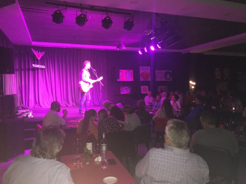 Hugh McGinlay on stage at Jimmy Hornet
