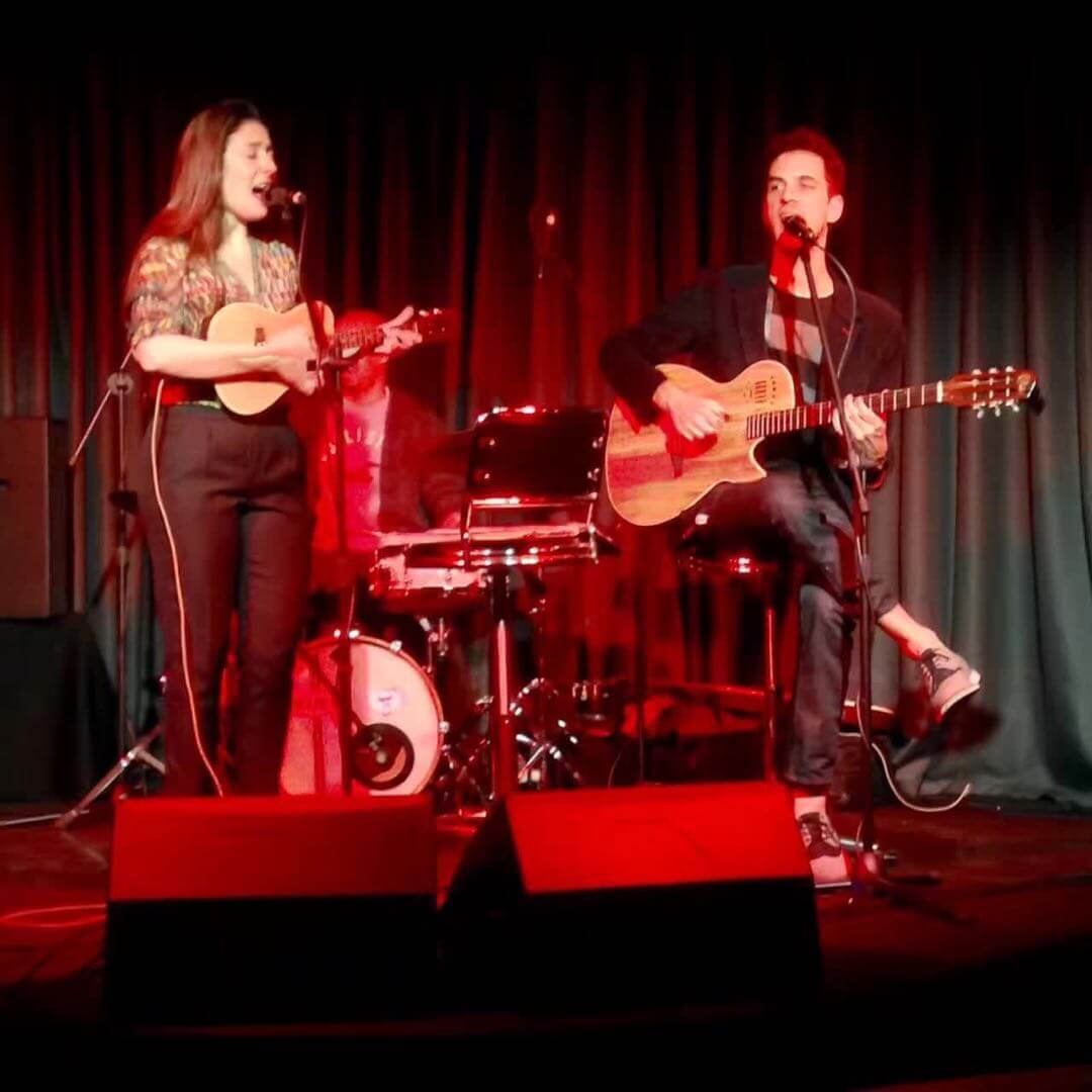 Veronica Nunes and Ricardo Vogt on stage at Jimmy Hornet